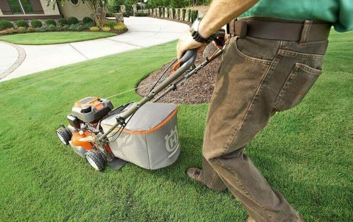 Man mowing with Husqvarna mower