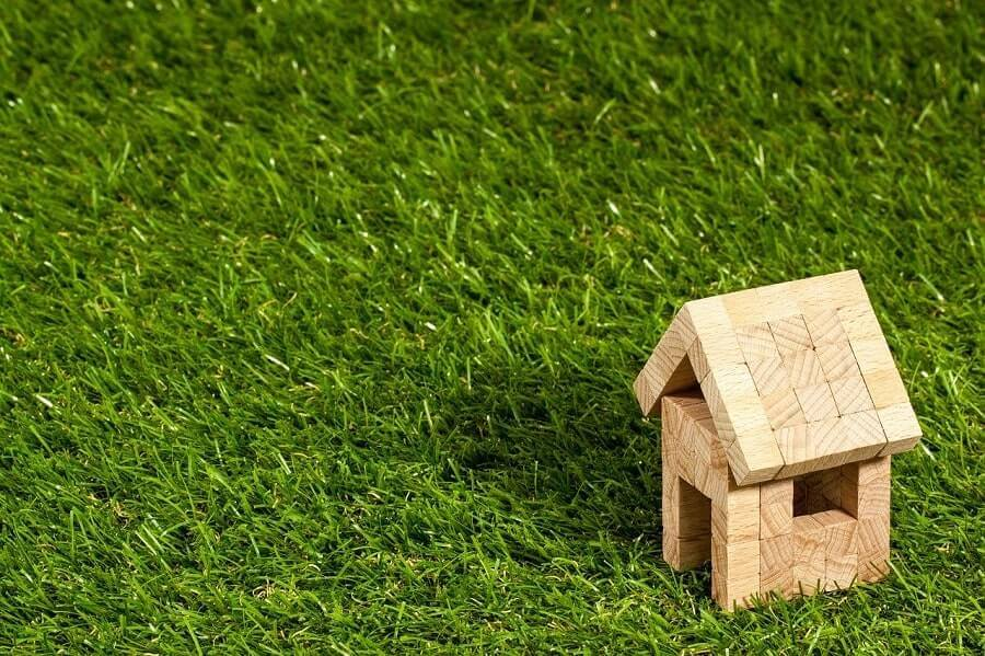 Toy house in green grass