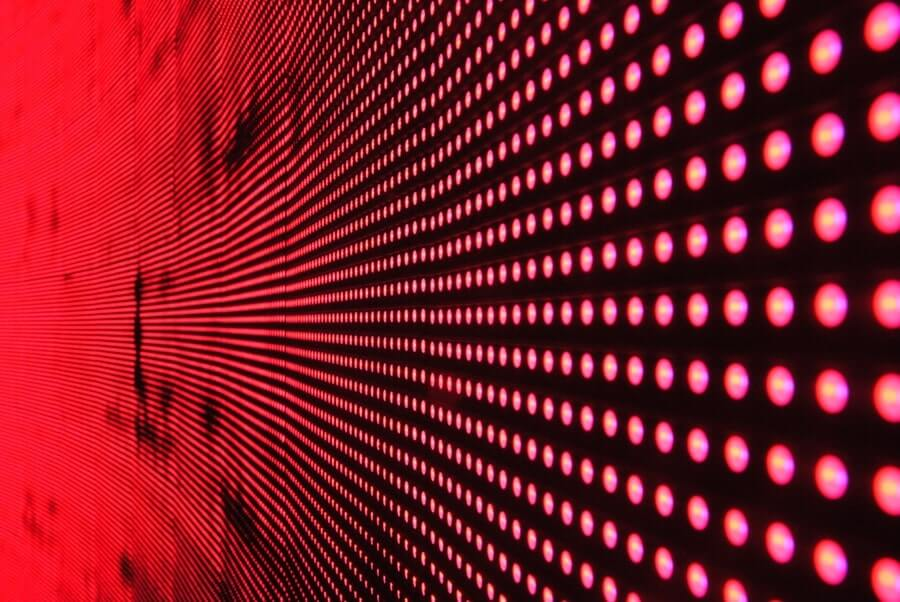 Red led lights in line on a wall