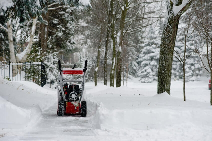 Snow blower on snowy pathway