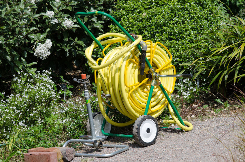 hose on reel used for irrigation in the garden