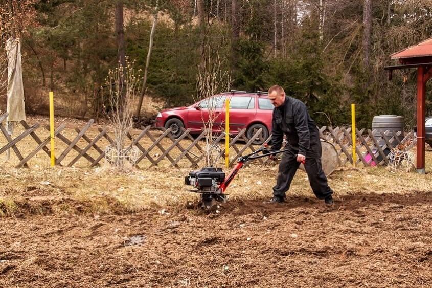 Man plowing garden