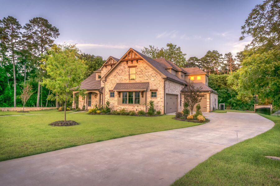 House with perfectly mowed driveway