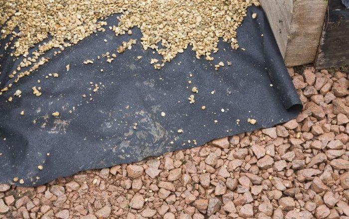 Landscaping fabric under rocks