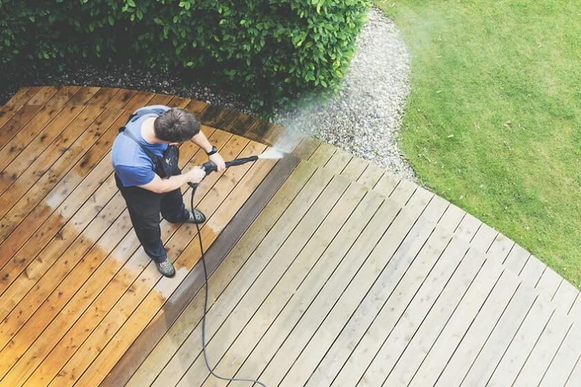 Man cleaning with pressure washer