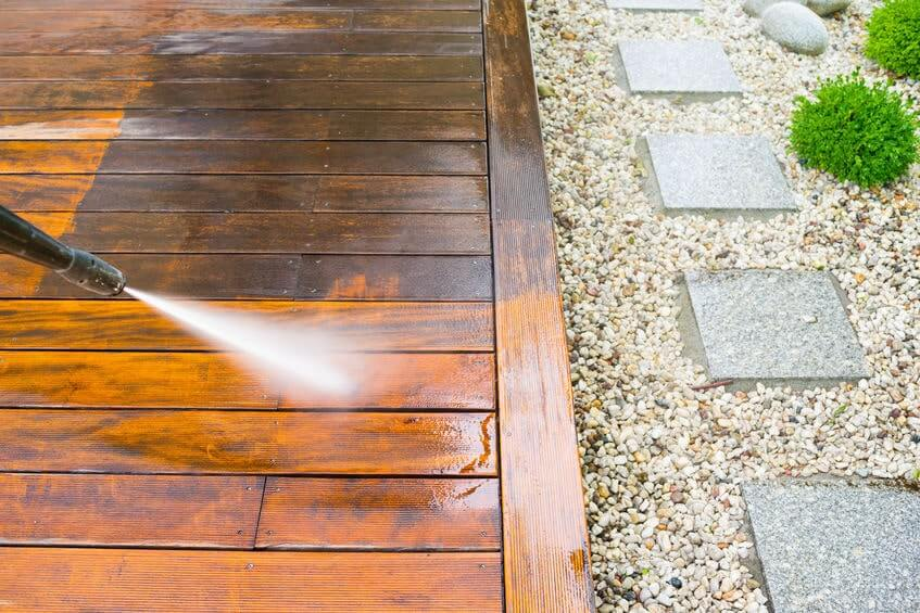 Washing a deck with a pressure washer
