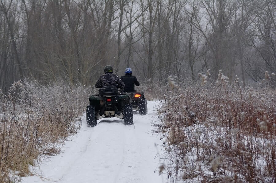 People riding ATVs in winter