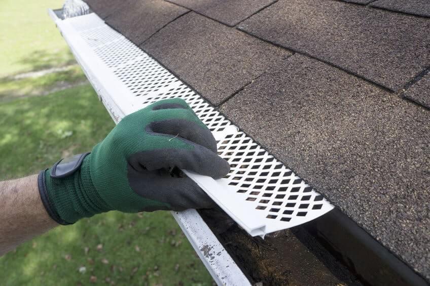Person installing gutter guard