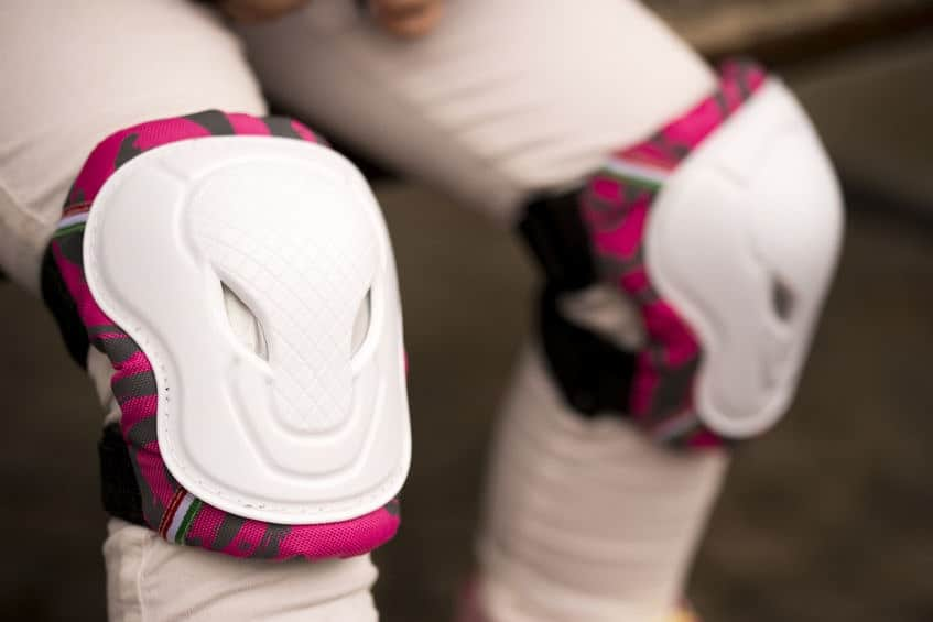 Woman wearing pink knee pads