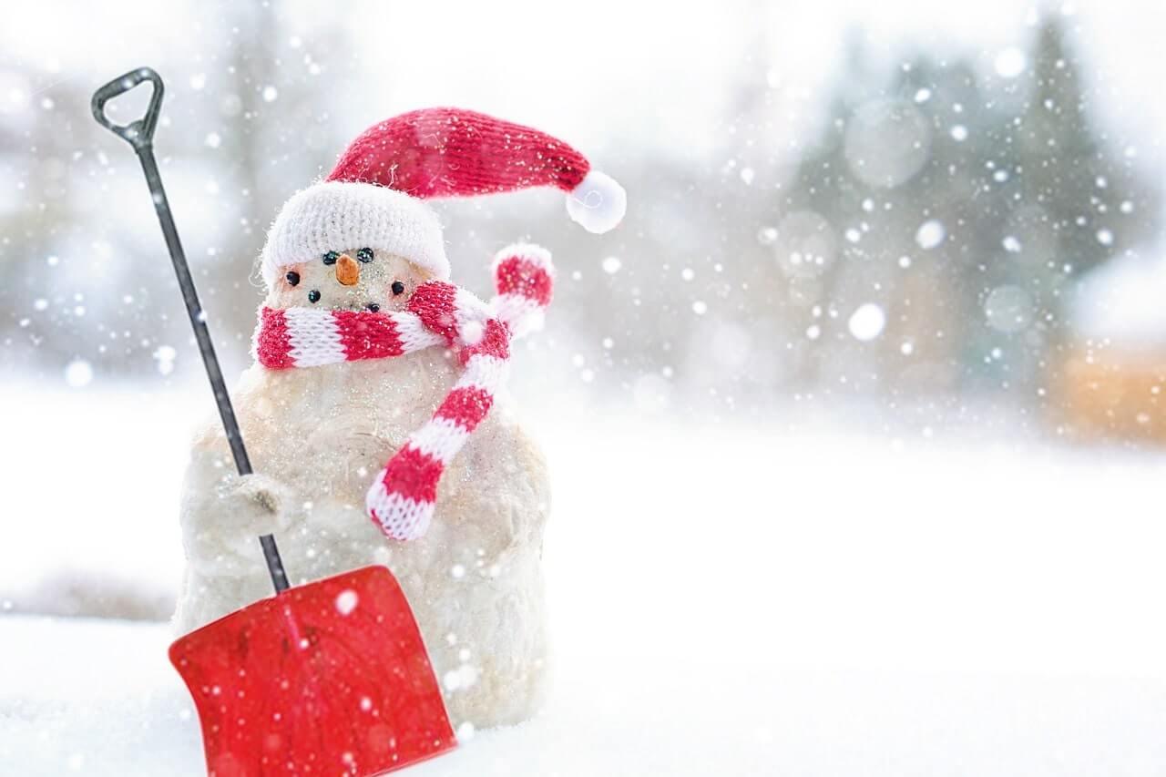 snowman holding a snow shovel