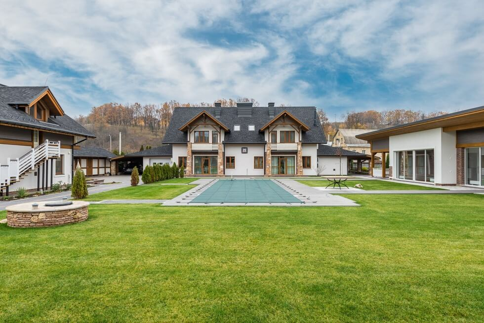 backyard lawn of a big house