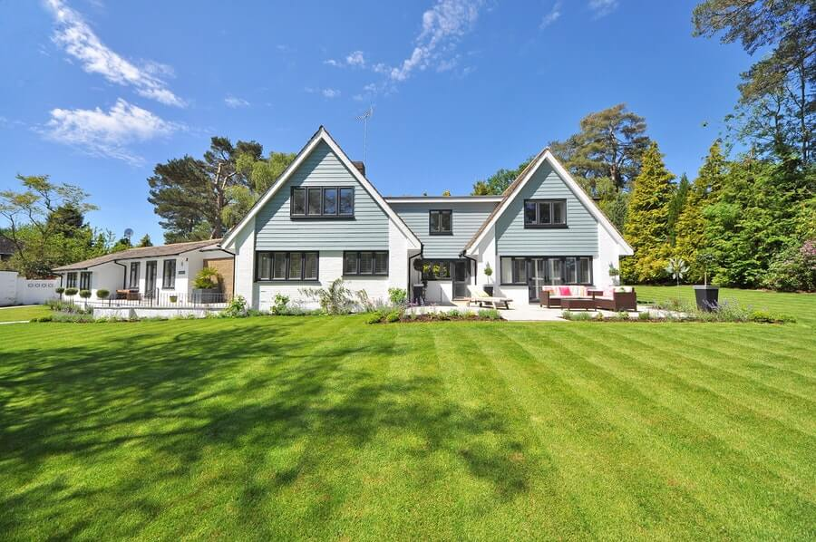 beautiful house with green grass front-yard lawn