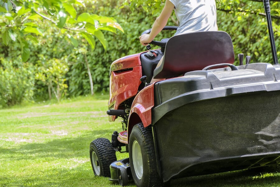 mowing the grass with riding lawn mower
