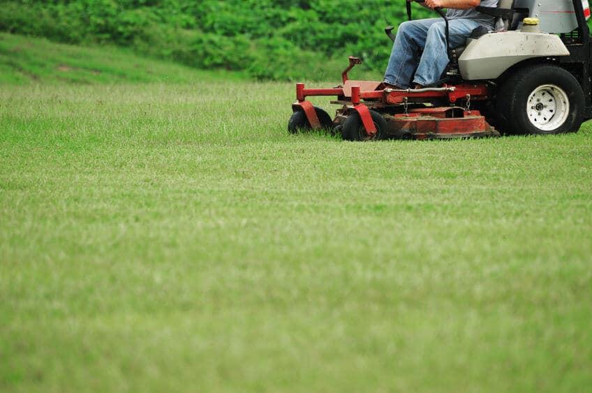 person using a professioanal zeru turn lawn mower